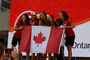 Canada women's national rugby sevens team - Sevens athletes for the 2015 Pan American Games pose with a fan.