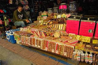 http://upload.wikimedia.org/wikipedia/commons/thumb/4/45/CandySellerSanJuan.jpg/320px-CandySellerSanJuan.jpg