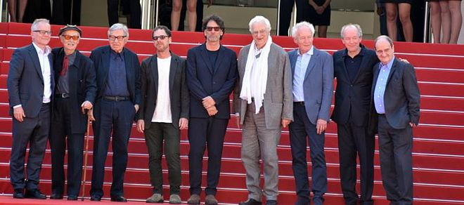 Beginning second from left: Film directors Vittorio and Paolo Taviani, Ethan and Joel Coen, Bertrand Tavernier, and Jean-Pierre and Luc Dardenne at the 2015 Cannes Film Festival, flanked by festival director Thierry Frémaux (far left) and president Pierre Lescure (far right) - Film director