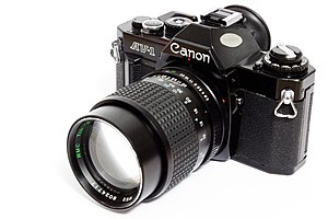 Canon av1 analog camera with 135mm lens.jpg