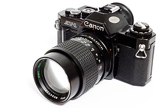 Canon AV-1 - Image: Canon av 1 analog camera with 135mm lens