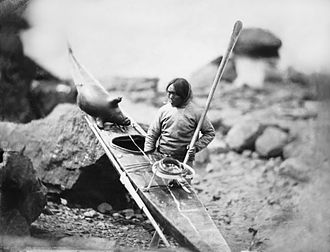 Kayak roll - An Inuit hunter with his kayak in 1854