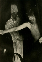 The fraud medium Eva Carrière in a séance with cardboard cut out figure of King Ferdinand of Bulgaria.