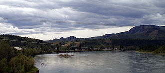 Carmacks, Yukon - Carmacks is seen from the Yukon River bridge with the river in the foreground.
