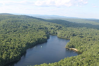 Casco area from the air with Netop Summer Camp in the foreground and Pleasant Lake in the background