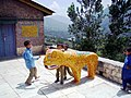 Children play with Waghoba at Manali temple.jpg