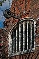 Church St Michael All Saints Bedford Park West Elevation Clock and Window Detail.jpg
