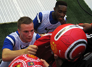 Tom Cleverley - Cleverley signing memorabilia alongside Danny Welbeck in 2011
