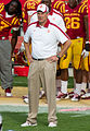 Coach Paul Rhoads standing on sideline.jpg