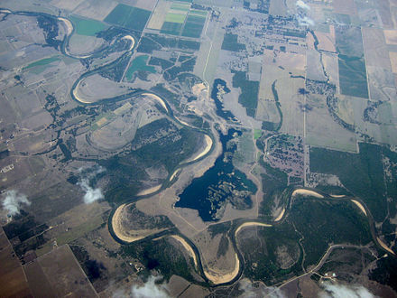 Oblique air photo of the Colorado River where it crosses from Colorado County into Wharton County near Nada. Colorado River Texas Nada.jpg