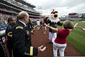Deanie Dempsey, the wife of the Chairman of the Joint Chiefs of Staff U.S. Army Gen. Martin E. Dempsey, embraces the Washington Nationals mascot, Screech, prior to Thursday's Major League Baseball game between 130704-D-VO565-008.jpg