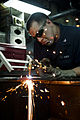 Defense.gov News Photo 110803-N-BT887-180 - U.S. Navy Petty Officer 3rd Class Jeffrey Meginness cuts sheet metal with an acetylene torch aboard the aircraft carrier USS John C. Stennis CVN 74.jpg