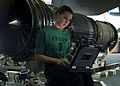 Defense.gov News Photo 120106-N-BT887-332 - Petty Officer 3rd Class Sarah Stone reads the instructions for installing a fire bottle into an F A-18E Super Hornet from Strike Fighter Squadron.jpg