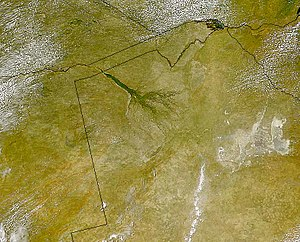 Makgadikgadi Pan - The Makgadikgadi pans are clearly visible to the right of the dark-green broom-shaped Okavango Delta in this satellite image of Botswana