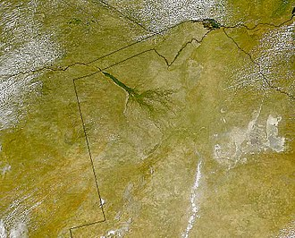 Endorheic basin - The Okavango Delta (centre) of southern Africa, where the Okavango River spills out into the empty trough of the Kalahari Desert. The area was a lake fed by the river during the Ice Ages. (National borders are superimposed on top.)
