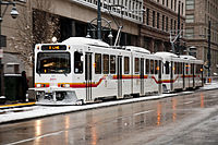 Denver LRVs in snow, on Stout St in downtown.jpg