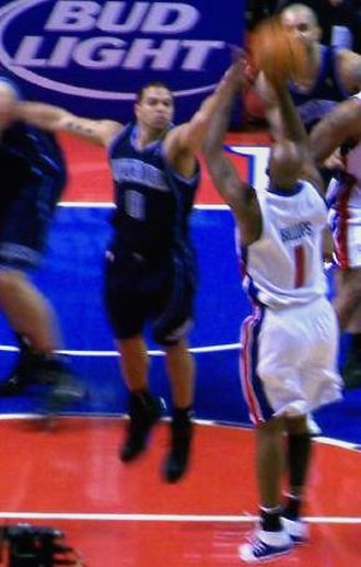 Deron Williams - Deron Williams with the Jazz attempting to block Chauncey Billups.