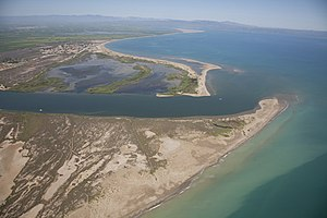 Base level - Aerial picture of the Ebro river as it reaches the Mediterranean sea by the Ebro Delta
