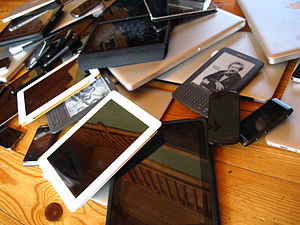 English: A pile of mobile devices including sm...