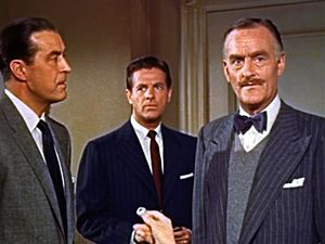 John Williams (actor) - A scene from Alfred Hitchcock's Dial M for Murder (1954). L-R: Ray Milland, Robert Cummings and John Williams.