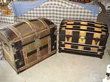Two Examples Of Dome Top Trunks: One Is A Vertical Slat Trunk, The Other Is  A Barrel Stave Trunk