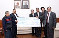 Dr. Jitendra Singh receiving a cheque of Rs. 50 lakh for flood relief in J&K from representatives of the IRCON International Limited.jpg