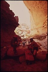 During a Week - Long Hike through the Maze, a Remote and Rugged Region in the Heart of the Canyonlands, Steve Miller and Glen Denny Enjoy a Lunch Stop in a Deep, Shady Canyon, 05-1972 (3814166919).jpg