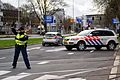 Dutch police woman regulates traffic at NSS.jpg