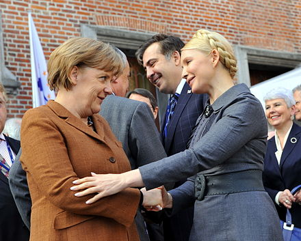 Yulia Tymoshenko (right), Angela Merkel and Mikhail Saakashvili EPP Summit March 2011 (67).jpg