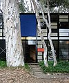 The front door and trees of the Eames House