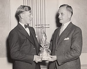 Ford National Reliability Air Tour - Eddie August Schneider on September 27, 1930 accepting the Great Lakes Trophy in Detroit, Michigan from David Vincent Stratton of the Great Lakes Aircraft Corporation