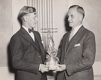 Great Lakes Aircraft Company - Eddie August Schneider on September 27, 1930 accepting the Great Lakes Trophy in Detroit, Michigan from David Vincent Stratton of the Great Lakes Aircraft Corporation