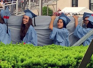 Columbia University rape controversy - Sulkowicz (center right) carrying the mattress at graduation