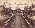 "Engineers and labourers in the engine room of R.M.S. ""Empress of Japan"" circa 1895.jpg"