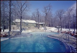 Exterior of Camp David lodge with swimming pool in foreground. - NARA - 194350.tif