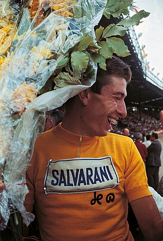 General classification in the Tour de France - Winner of the 1965 Tour's general classification Felice Gimondi wearing the yellow jersey with the initials of Henri Desgrange, the first organiser of the Tour de France