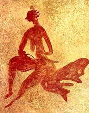 Rock art - Female figure at the Tassili n'Ajjer mountain range.