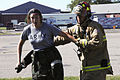 Firefighter TSgt Kurt Brunsman aids a tornado casualty portrayed by a Michigan Civil Air Patrol Cadet.JPG