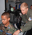 First Lt. Brian Crum guides Parker Merrifield, a Texas Wing Civil Air Patrol cadet.jpg