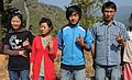 First time voters showing the ink mark on their finger after casting their vote at a polling booth of Ukhrul district, during the Manipur Assembly Election on January 28, 2012.jpg