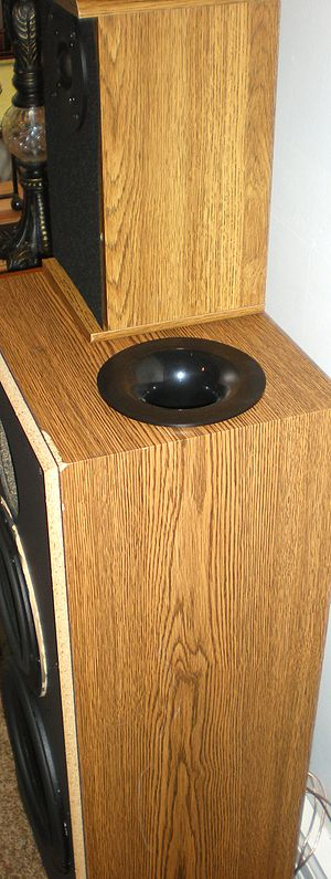 Bass reflex - Two inch port tube installed in the top of a Polk S10 speaker cabinet as part of a DIY audio project. This port is flared.