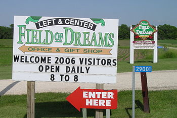 Two signs mark the entrances to the Field of D...