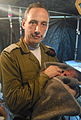 Flickr - Israel Defense Forces - Doctor Abergel Holding Baby.jpg