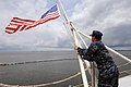 Flickr - Official U.S. Navy Imagery - A Sailor adjusts the American flag to half-mast in remembrance..jpg