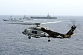 Flickr - Official U.S. Navy Imagery - A helicopter is airborne while participate a trilateral event..jpg