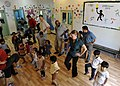 Flickr - Official U.S. Navy Imagery - Sailors dance with children..jpg