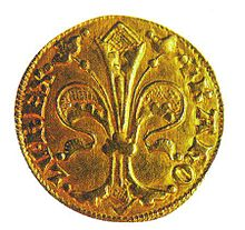 A golden coin depicting a lily