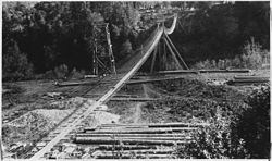 A footbridge at Angess over the Rogue River, circa 1927