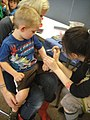 Free Comic Book Day 2012 - getting a shield tattoo (7186411490).jpg