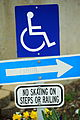 Free Handicap Wheelchair Symbol, Arrow and No Skating Sign Creative Commons.jpg